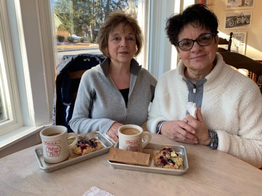 Two women at table for National Muffin Day