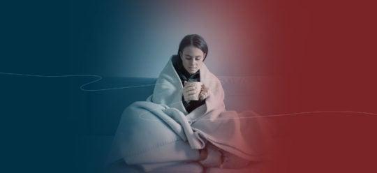 Woman bundled up in blanket