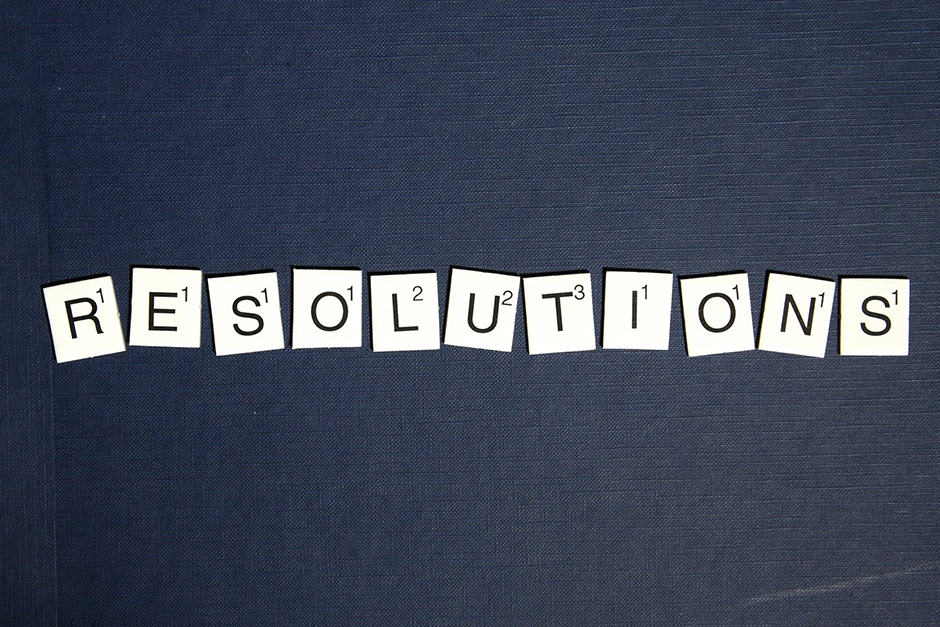 Scrabble piece letters spelling out the word Resolutions