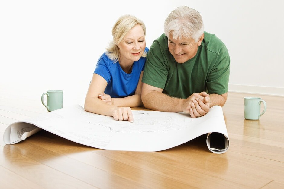 a couple reviews blueprints and plans how to use their personal loan for home renovations