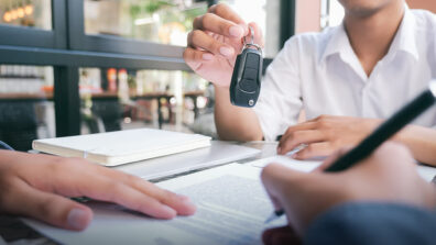 a customer signs a car loan and gets the keys