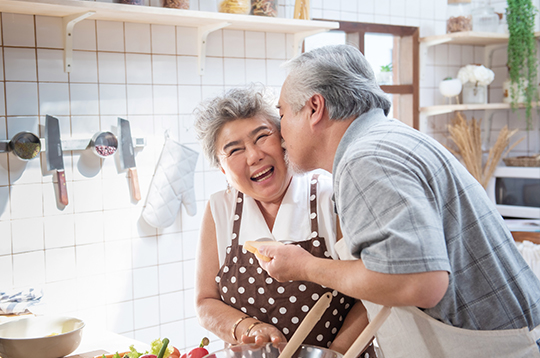 couple-embrace-in-kitchen-refinance-mcti2
