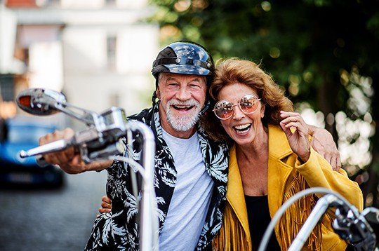 Couple smiling on motorcycle
