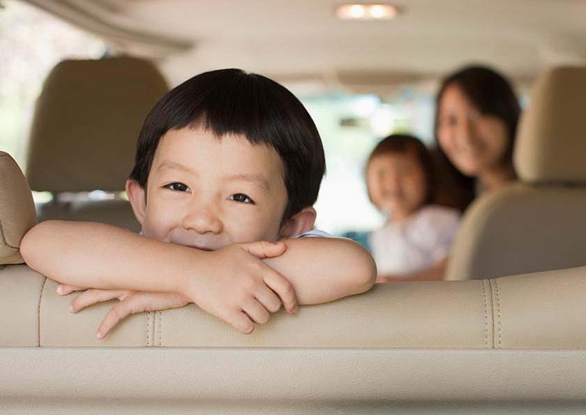 happy-family-in-car-hero