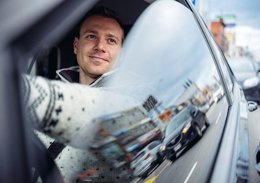 man-driving-with-window-down-hero