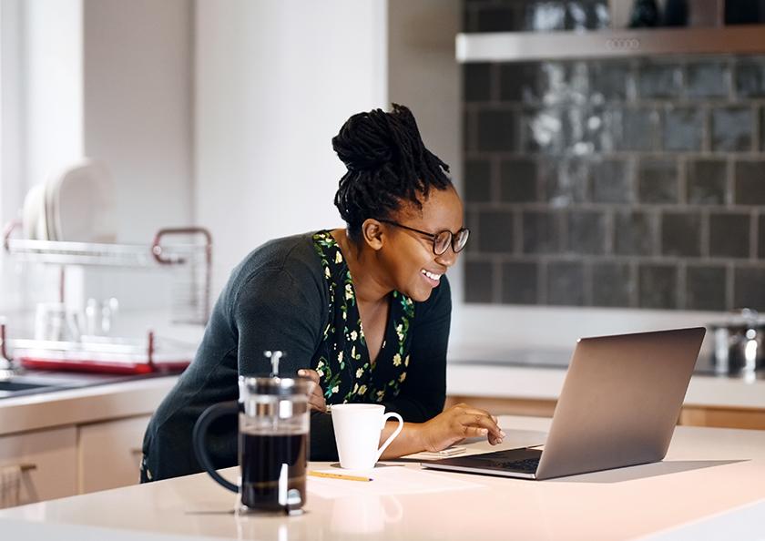 woman-applying-for-loan-on-laptop-hero